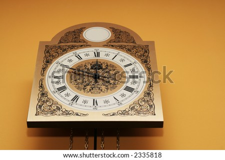 Old clock face showing the time.Clock showing midnight or noon time