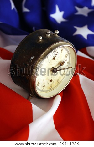 old clock standing on an american flag