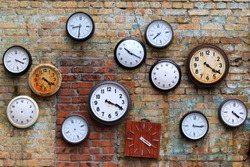old clocks on the brick wall - time, time change, timeless