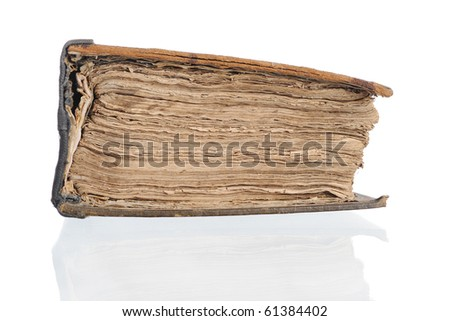 Old closed Bible. Isolated on white background
