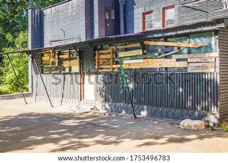 Old closed black shop with boarded up windows Photo stock ©