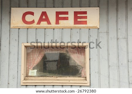 Old closed cafe restaurant building and sign