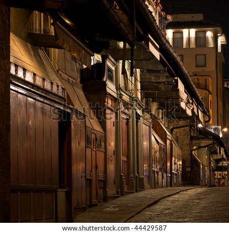 stock-photo-old-closed-shops-at-night-44429587.jpg