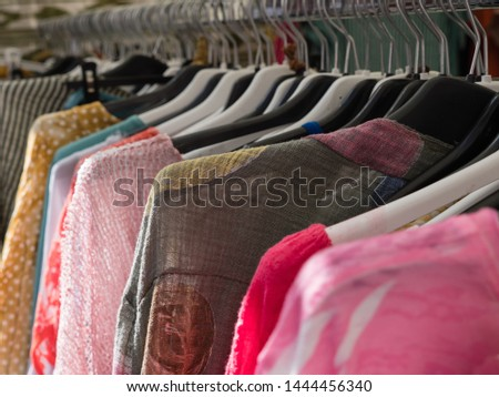 old clothes on hangers on a clothes rail