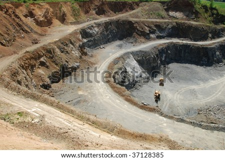 Old coal mine with machines gathering the resources