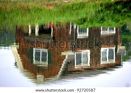 Old Coastal Maine Barn reflected in shallow inlet
