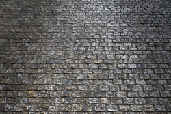 old cobblestone street at night backlit background texture