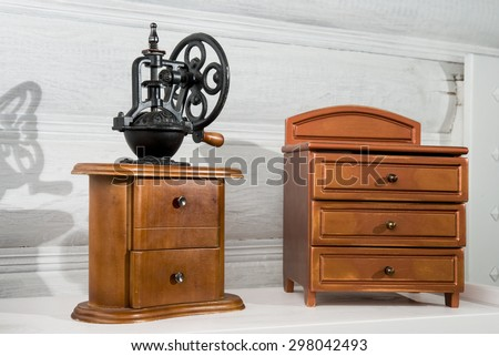 old coffee grinder on a wooden nightstand #298042493