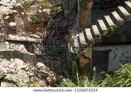 Old collapsing staircase without railings and supports #1106852024