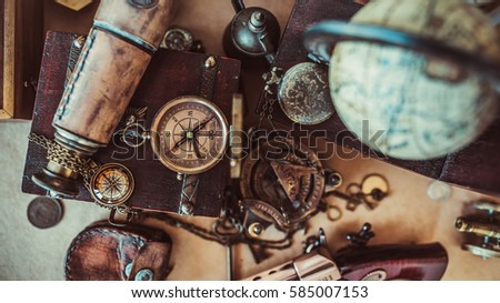 Old collection compass, binoculars and adventure device items in vintage style image. #585007153