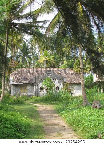 Old  colonial house influenced by Dutch architecture  and surrounded by palm trees,in Polhena town, Sri Lanka