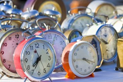 Old colored metal table clocks - concept image