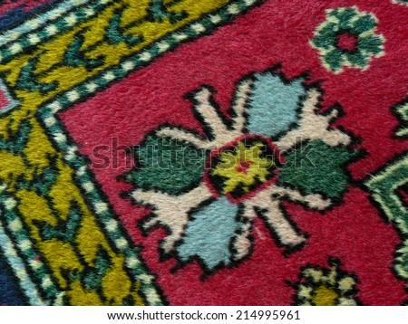 old colorful carpet fragment