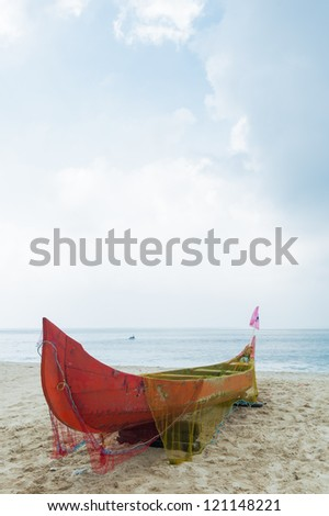 Old colorful fishing net on fishing boat in Kerala India. LAndsc