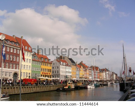 Old colorful houses in the harbor named Nyhavn famours for all the restaurants and atmosphere