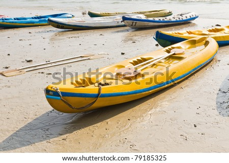 Old Colorful kayaks on the beach