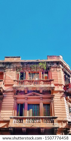 old colorful pink facade antique