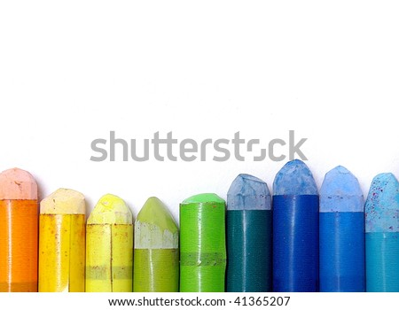 Old colorful wax crayons isolated in a white background