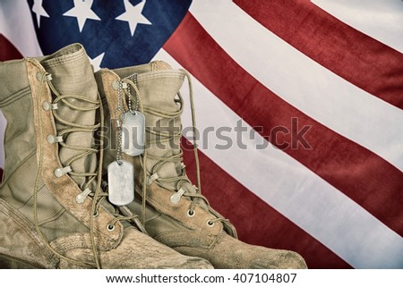 old combat boots and dog tags...