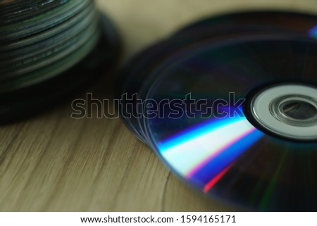 old compact discs on the table