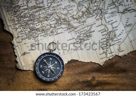 Old compass and ancient map