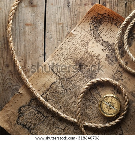 old compass and rope on vintage ...