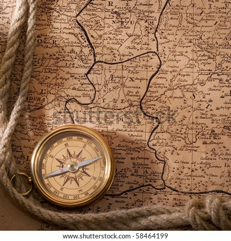 old compass and rope on vintage map 1781