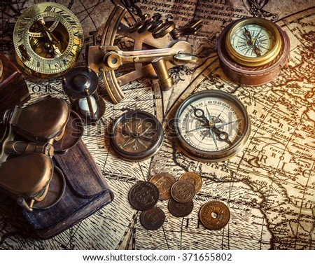 Old compass, astrolabe on vintage map. Retro style. #371655802
