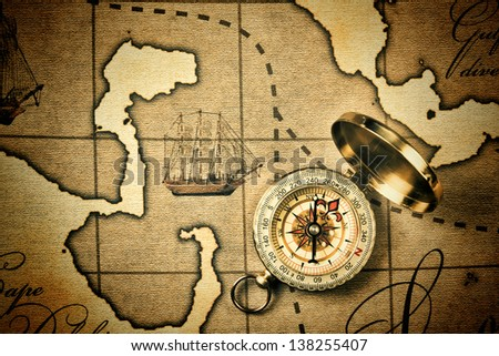 Old compass on a stylized map