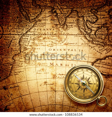 old compass on vintage map 1746 - stock photo