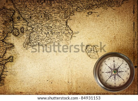 old compass on vintage map 18 centuries