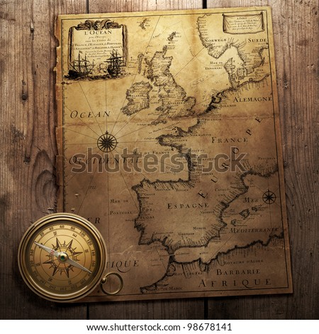 old compass on vintage map (France, Spain, England, Portugal, Holland, Denmark  author Pierre Du Val (1618-1683) Paris. France 1666 )