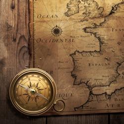 old compass on vintage map (France, Spain, England, Portugal, Holland, Denmark author Pierre Du Val (1618-1683) Paris. France 1666 )