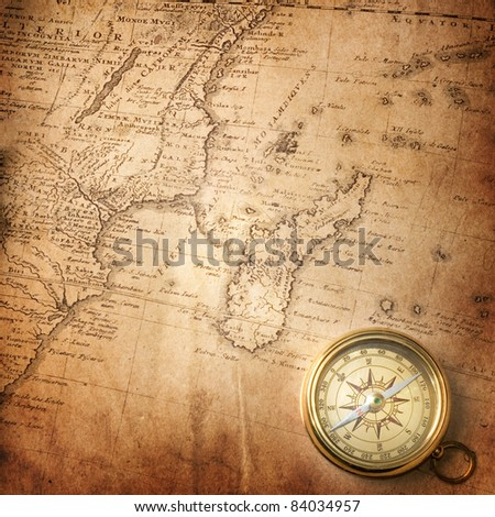 old compass on vintage map ( map Africa mapmaker: Io Matthia Hasio, publisher: Homannianorum H, 1737)