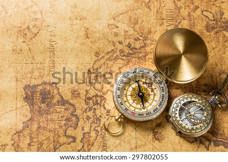 Old compass on vintage map. Retro stale #297802055