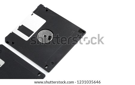 Old computer diskette over white background. Black Diskette.