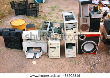 Old computer parts and electronic junk in flea market - stock photo