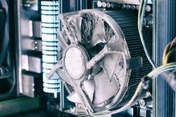 Old computer system unit cooler with dust inside. Brocken computer parts concept