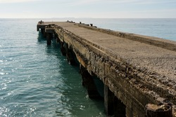 Old concrete deck on the sea