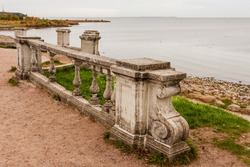 Old concrete railing against the sea.