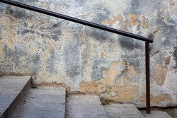 Old concrete staircase railing, detail of a old public stairs