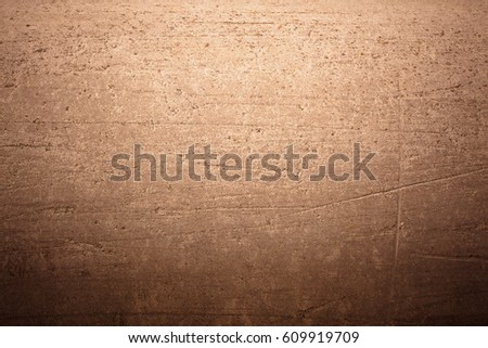 Old concrete texture with scuffs, chips and scratches in warm color