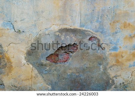 Old concrete wall with cracked grout and red bricks