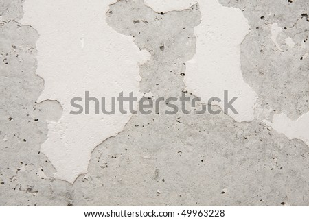 Old concrete wall with plaster residues