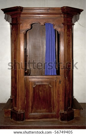 Old confessional inside the abbey of Chiaravalle in Pavia, Italy