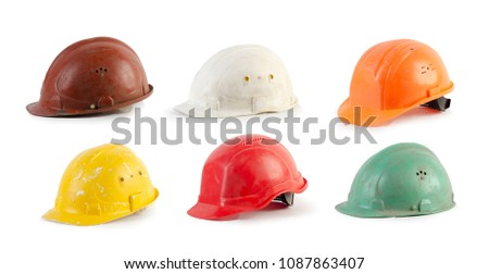 old construction helmets isolated on white background