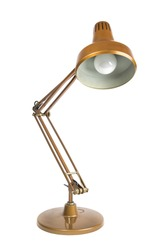 old copper colored table lamp on white background / isolated portrait of a vintage table lamp
