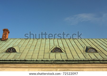Old copper roof against the sky #72522097
