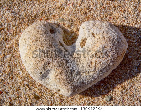 Old coral rock shaped naturally into a heart shape as found on a brushy sand beach in Cuba near Trindade. Heavily worn stone in the shape of a heart. #1306425661