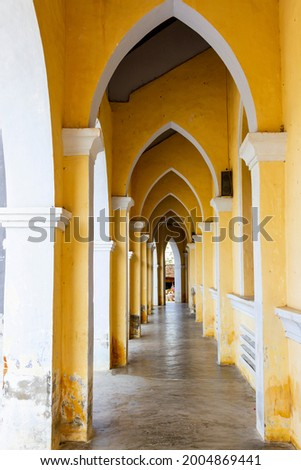 Old Corridor Of Mang Lang Church In Phu Yen Province, Vietnam. Mang Lang Church Is One Of The Oldest Churches In Vietnam Imbued With An Architectural Style Of The 19th Century Stock fotó ©